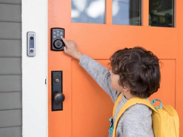 Child At Front Door Pressing Electronic Lock