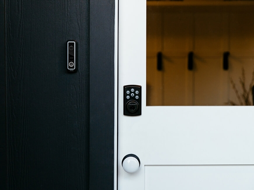 Door with lock and doorbell camera